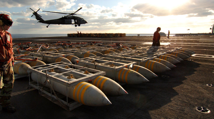 051104-N-2984R-169 Atlantic Ocean (Nov. 4, 2005) Ð Aviation Ordnancemen assigned to Weapons Department prepare pallets of BLU-117 2,000-pound general-purpose bombs to be airlifted from the flight deck of the Nimitz-class aircraft carrier USS Harry S. Truman (CVN 75) to USS Dwight D. Eisenhower (CVN 69) during an ammunition offload. Truman and Eisenhower are currently underway in the Atlantic Ocean conducting ammunition offloads and underway replenishments. U.S. Navy photo by Photographer's Mate Airman Ricardo J. Reyes (RELEASED)