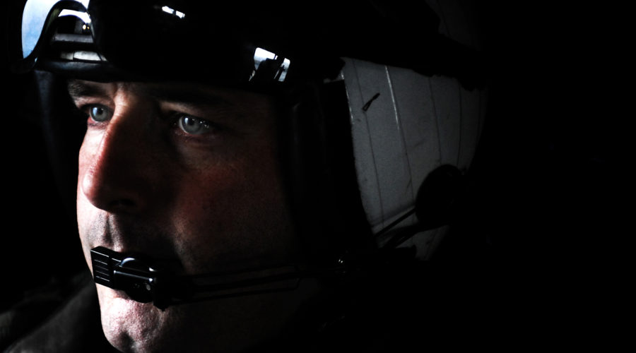 "Chief Naval Air Crewman Troy Rankin, assigned to the ""Dragonslayers"" of Helicopter Anti-Submarine Squadron Eleven 11, observes flight operations aboard the aircraft carrier USS Harry S. Truman. Truman is conducting carrier qualifications."