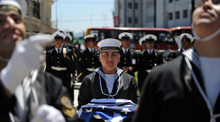 A Chilean honor guard member holds both the American and the Chilean flags during a ceremony at the Monument to the Heroes of Iquique. Sailors assigned to High Speed Vessel Swift (HSV 2) laid a wreath in front of the monument. Swift is in Valparaiso participating in Expo Naval 2010 as part of Southern Partnership Station 2011. Southern Partnership Station is an annual deployment of U.S. ships to the U.S. Southern Command area of responsibility in the Caribbean and Latin America.